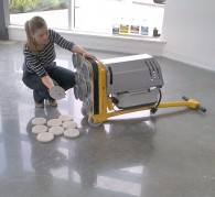 Mechanically polishing a concrete floor