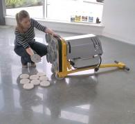Mechanically polishing a concrete floor