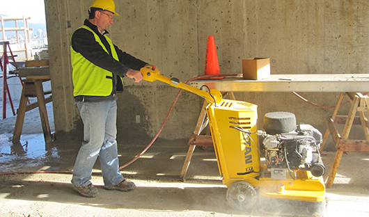concrete-grinder-removing-glue