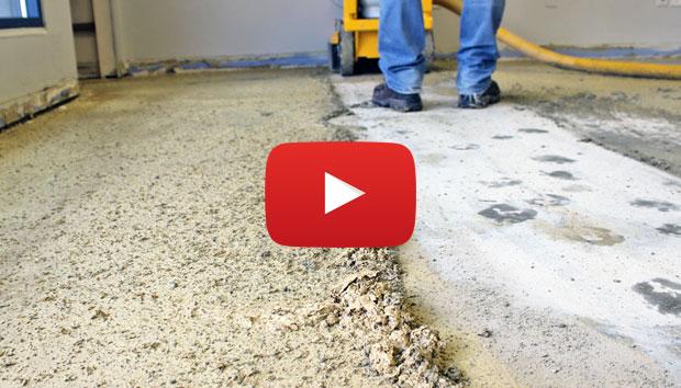 Grinding off carpet glue with concrete grinder